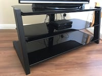 Tv stand excellent condition  2250 mi