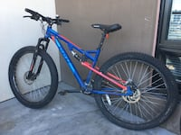 Blue and red full suspension mountain bike.
