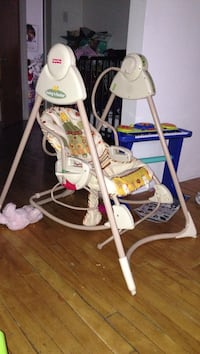 white Fisher-Price swing chair