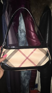 women's brown and pink leather sling bag New York, 10039