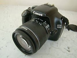 Canon DSLR EOS 1100 with 2 lenses, stand, camera bag, and accessories