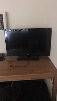 black flat screen TV with remote Los Angeles, 90008