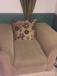 Beige fabric sofa chair with throw pillow Ajax