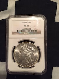 round silver coin in box New York, 10458