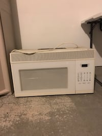 white General Electric microwave oven Houston, 77019
