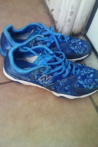 pair of blue New Balance low-top sneakers