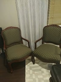 two brown wooden framed green padded armchairs Cambridge, N1R 8A8
