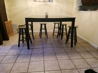 Kitchen table and 6 chairs 2344 mi