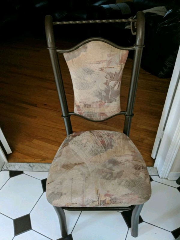 brown wooden frame white padded chair
