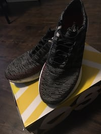 Pair of black adidas low-top sneakers with box