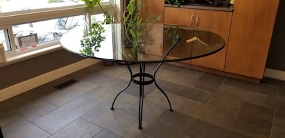 """Large 52"""" glass table on wrought iron legs"""