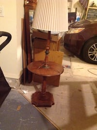 Round table with lamp on it.