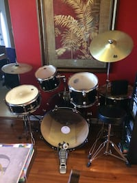 black, silver, and brass drum set