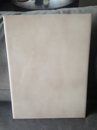 Ceramic tile - measures 6x8.  Tile is beige with slight marbling accent.  There are 33 tiles available  Mississauga