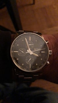 round silver-colored chronograph watch with link bracelet 217 mi