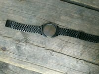 round black analog watch Nixon  Edmonton, T5L 3G9