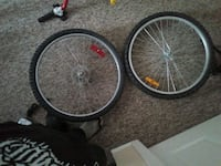 two black bicycle rims with tires Red Deer, T4R 2M9