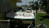 white and blue motorboat Hallandale Beach, 33009