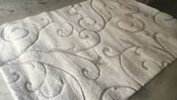 gray and black floral area rug