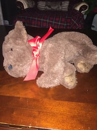 brown bear plush toy with red bow