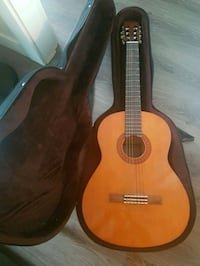 brown classical guitar with gig bag North Vancouver, V7L