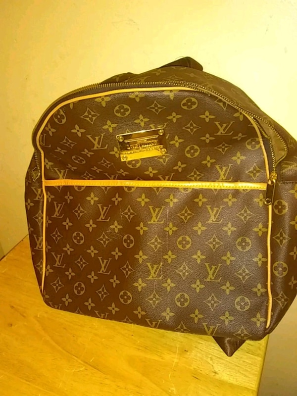 brown Louis Vuitton leather backpack