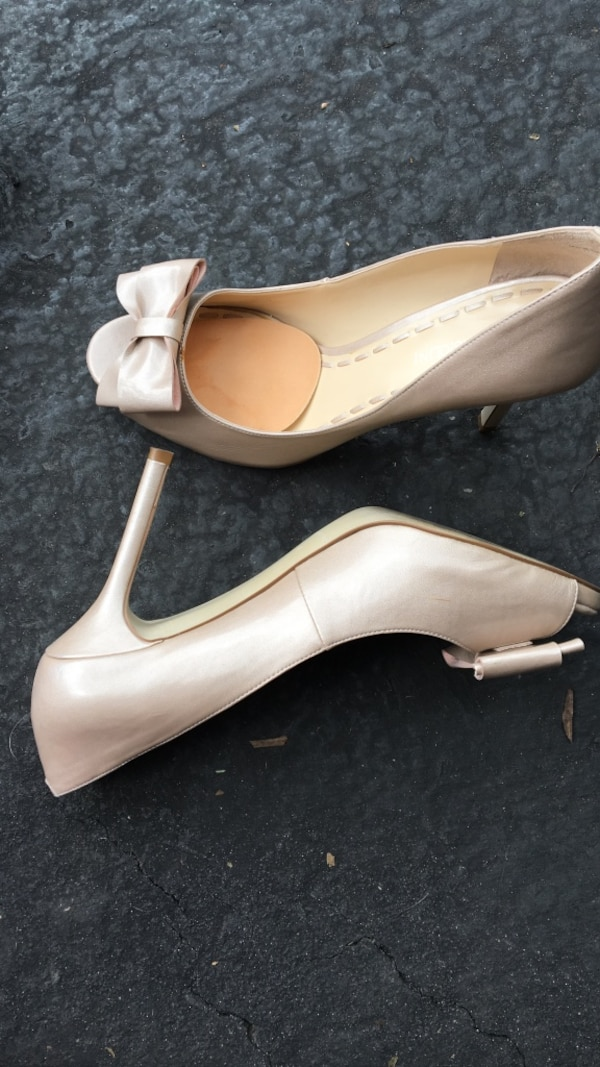 pair of grey patent leather peep-toe platform pump shoes with bow