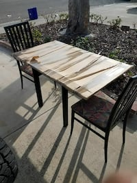 rectangular brown wooden table with 2 chairs