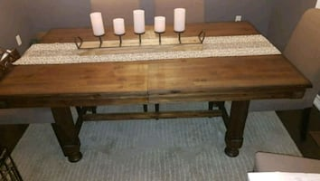 Beautiful solid wood dining table, expandable to seat 8.