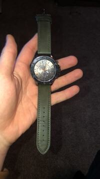 round silver chronograph watch with black leather strap Niles, 49120