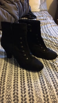 Pair of black suede cone-heeled lace-up boots