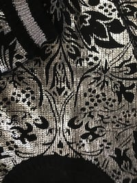 sequined gray and black floral cloth