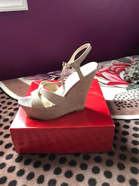 pair of gray-and-brown wedge sandals 43 km