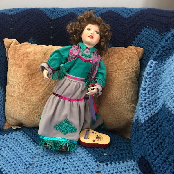 Two girl in blue and pink dress dolls