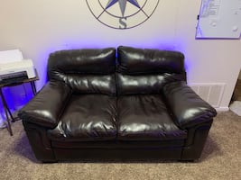 Used leather love seat