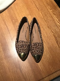 pair of brown-and-black Leopard print flats