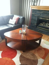 round brown wooden framed glass top coffee table Calgary, T2P 0G9