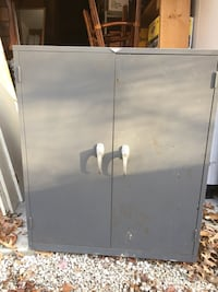 Gray locking filing cabinet with combination safe.
