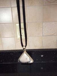 Marble and sterling silver pendant on cord chain. North Reading, 01864