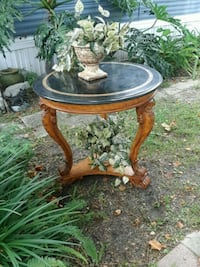 Round claw foot style table depicting elephant hea Atlantic Beach, 32233
