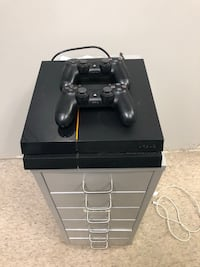black Sony PS4 console with controller Brampton, L6T 5V7