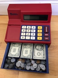Red and blue cash register toy
