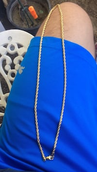 gold-colored lobster-clasp necklace