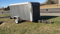 black and gray enclosed trailer 61 km