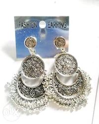 pair of silver-colored earrings 13779 km
