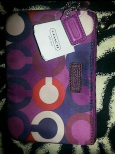 purple, pink, and white Coach monogram pouch