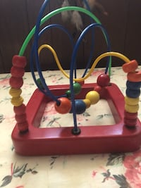 Baby's red and blue activity gym in excellent condition