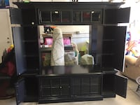 Black entertainment center used.   Comes apart in 4 pieces.   Has a light in the top tv stand Palmdale, 93551