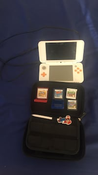 White nintendo ds with game cartridges Montgomery Village, 20886