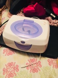white and purple wipes warmer Montréal, H2X 2C6